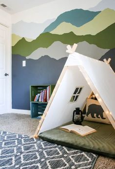 He's especially wild about the new tent with string lights. Ich creates to coziest little reading nook in his bedroom. If you're looking for kid's r Playroom Design, Kids Room Design, Playroom Decor, Playroom Storage, Boy Decor, Toy Storage, Kids Decor, Decor Ideas, Mountain Mural