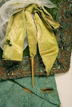 c. 1580 doublet, European, made of silk, metallic thread, brass, The Metropolitan Museum of Art (detail of the decorative silk thread ribbons at the hem) note: the white silk crepé is for the garment support/protection while in the storage, not part of the doublet!