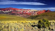 It's all in the geography: a rainbow of eleven different rock layers gives the peaks their...