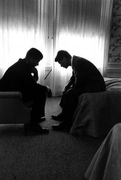 Presidential candidate John F. Kennedy confers with his brother and campaign organizer, Robert Kennedy, in a hotel suite during the 1960 Democratic National Convention in Los Angeles.