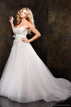 I definitely want my wedding dress with sleeves, lace, pearls purple underneath & backless. Decisions Decisions!!!