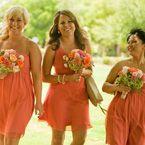 I like these orange bridesmaid dresses for a beach wedding