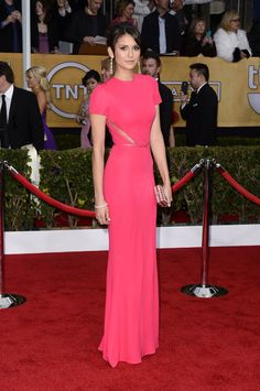 Among a sea of black, Nina Dobrev's pink crepe Elie Saab gown was a welcome pop of color. The brunette stunner upped the glam factor with diamond drop earrings, a matching bracelet, and mirrored minaudiére. #SAGAwards