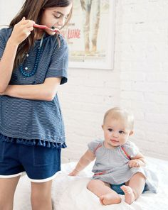 MAY '14 Style Guide: J.Crew girls' top in tassel stripe, pull-on knit short and bead and flower necklace.