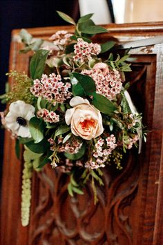 Thanksgiving wedding celebration in English countryside flowers along the pews – Aaron Delesie Photography