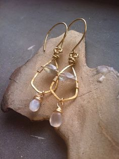 These hand formed and hammered wire wrapped brass earrings have a beautiful contrast between the earthy, rustic brass and ethereal, iridescent
