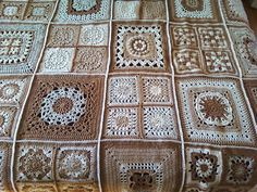 This is a hand crocheted afghan made in shades of brown and white. The yarn I used is 100% acrylic, so this afghan can be machine washed and dried, making it extremely easy care.