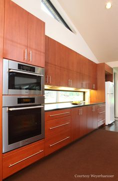 Sleek lines and rich tropical hues a kitchen do make.  Custom Lyptus hardwood cabinets by Huggy Bear's Cupboards.