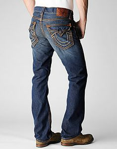 998d29d2b Signature Super T stitching highlights this classic straight leg jean for a  look that is uniquely True Religion. The rust brown shade is a rustic