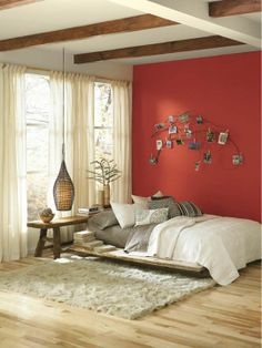 Your room is begging for an accent wall. Give it a couple coats of a rich color like orange paint color Cayenne (SW 6881).