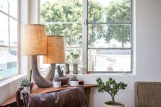 12 Ways to Fill Empty, Awkward Corners: table, blankets (on stand or ladder), plants (on stool), shelving, seating, lighting