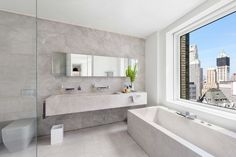 In the master bathroom, the Nordic marble sink and bathtub was designed by fashion designer Jeffrey Dodd. #bathroom #marblebathroom #marble #nordic