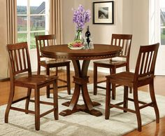 Counter Ht. Table With 4 Chairs 5Pc.Set Foster II Collection CM3437PTMake your dining room unique with this pedestal table decorated with nailhead trim. Matching slated chairs accompany this table.• Transitional Style• Plank Design• Nailhead Trim• Slated Back Chairs• Solid Wood, Wood Veneer