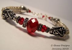 Sterling Silver Viking Knit with Red Crystals
