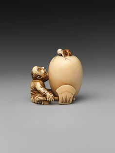 Netsuke of a Man and an Egg Date: 19th century Culture: Japan Medium: Ivory Dimensions: H. 1 1/4 in. (3.2 cm); W. 1 1/4 in. (3.2 cm); D. 1 in. (2.5 cm)