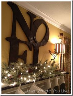Love the idea of using a curtain rod to hang Christmas stockings - and love the Pottery Barn stocking holders and twig reindeer!