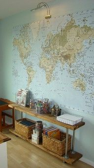 the map fades away into a soft blue wall the portrait lamp above the map baskets! accessible paper and art materials, but not clutter.