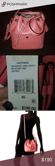 "MICHAEL KORS PURSE Greenwich Medium Bucket Bag - RETAILS  $298 + tax = $327.00 - color : coral/Prgrey(inside)  EXTERIOR - Detachable silver tone 'MK' logo charm with clochette cover key  - Approx. measures:  10"" L  x 9.25"" H x  5.5"" D - One handle with approx. drop 11"" - One adjustable and detachable shoulder strap with approx. drop 19-23"" - Magnetic snap closure - Silver tone hardware - Snap pocket in the front  - Four protective feet at the bottom  NTERIOR  - prgrey color - One large slip…"