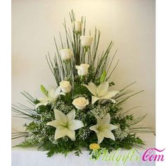Symmetrical floral arrangement containing white roses