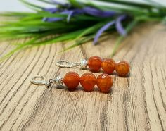 Check out this item in my Etsy shop https://www.etsy.com/uk/listing/251078630/fire-agate-earrings-silver-drop-earrings