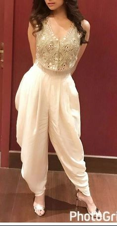 Fusion - East meets west Mirrored ethnic top with White Dhoti style baggy pants - love! Party Wear Indian Dresses, Designer Party Wear Dresses, Indian Fashion Dresses, Indian Bridal Outfits, Indian Gowns Dresses, Kurti Designs Party Wear, Dress Indian Style, Indian Designer Outfits, Gown Party Wear