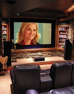 Theater room-basement. Like the built in shelves and rock. If I wanted a theater this is what I would want it to look like Doorley Doorley Matthews
