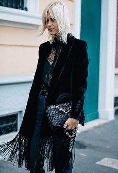 Linda Tol photographed at Milan Fashion Week wearing a Blaze Milano fringed jacket.