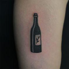 Tattoo Artist: Jenna Bouma aka Slowerblack - East River Tattoo, BK NYC www.tatteo.com  poked a little wine bottle for jack. @eastrivertattoo