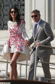 George Clooney and Amal Alamuddin Make a Perfect Pair of Newlyweds: George Clooney and Amal Alamuddin made their first public appearance as a married couple on in Venice when they left their hotel on Sunday morning.