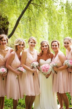 Beautiful blush pink bridesmaid dress. The v-neckline is so flattering | One One Photography www.oneone.co