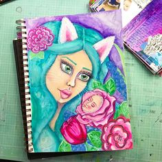 A mixed media painting that I am currently working on in one of my art journals, mostly using mermaid markers , acrylic paint and posca paint markers , check out my instagram , YouTube or blog for more !