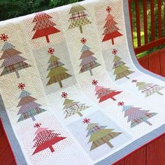 What a cute Christmas quilt. The Christmas tree star is made using the Ohio Star