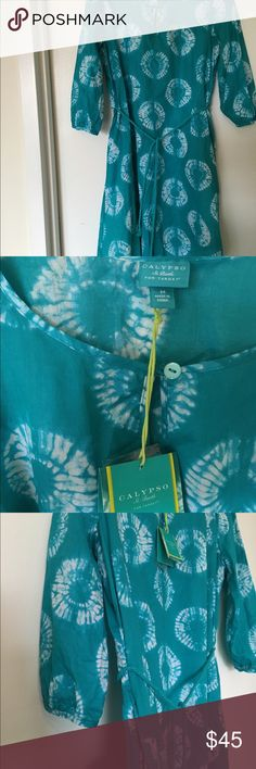 """Calypso x Target beach coverup Sz Med New with tags, never worn. Lightweight 100% cotton turquoise and white tie-dye look, with optional belt. Pockets, ¾ sleeves. Limited edition Calypso St. Barth line for Target. I'm 5'4"""" and it hits just at the top of my knee. Calypso St. Barth Swim Coverups"""
