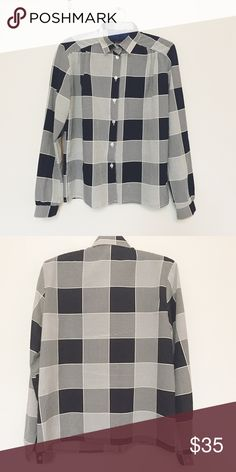 Vintage Black&White Shirt Vintage shirt in excellent used condition. No flaws. Tuck it into a highwaist skirt or pants for an awesome look. No size tag, would fit S/M. Vintage Tops Button Down Shirts