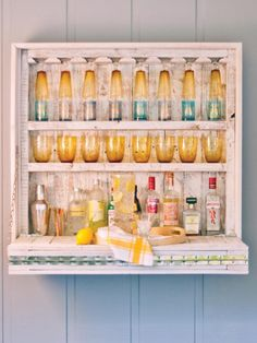 Transform wooden packing pallets into a hanging outdoor bar complete with a fold-up shelf with expert how-to tips from HGTV.com.