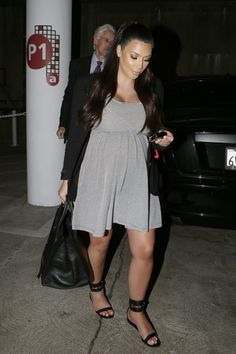 Kim Kardashian opts for comfy maternity-wear with a loose striped dress and gladiator sandals as she goes into a medical building in Los Angeles