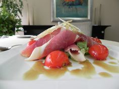 Prosciutto from Njegus on lettuce mix (prosciutto, lettuce selection, Parmesan, pumpkin seed oil, cherry tomato)