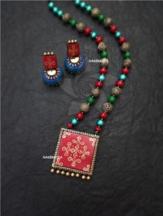 Kolam 1 - Colour : Antique gold, maroon green and blue Colour may vary slightly due to photography and moni - Jewelry Model, Clay Jewelry, Jewelry Crafts, Beaded Jewelry, Beaded Necklaces, Designer Jewelry, Terracotta Jewellery Online, Terracotta Jewellery Designs, Teracotta Jewellery