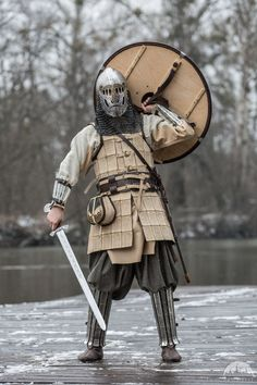 A stainless steel and brass helmet loosely inspired by the Vendel Period.