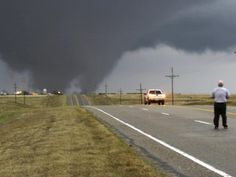 Beaver County, Oklahoma A man stands in the road as a tornado crosses U. Highway 270 on Wednesday, March The storm swept from the Rockies into the plains, killing at least four people in three states. All Nature, Science And Nature, Amazing Nature, Weather Cloud, Wild Weather, Weather Storm, Tornados, Thunderstorms, Severe Weather