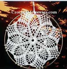 Regardless if you work this for its intended purpose, a sun catcher, or as a doily, the sweet dainty pineapples are sure to please. Non traditional in that they are not edged with shells but simpl...