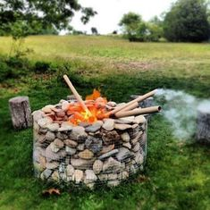 """Continuing my work on the """"earth air fire & water"""" theme in our """"back forty"""" out in our summer place in Springs NY (see yurt raising here) I just (this weekend) finally finished getting the super cool new wood stove powered hot tub ready for use. Easy Fire Pit, Fire Pits, Gabion Wall, Modern Fire Pit, Fire Pit Designs, Fire Pit Backyard, Outdoor Fire, Outdoor Swings, Outdoor Stove"""
