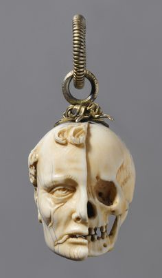 An ivory rosary bead in the form of a momento mori ~16th century