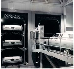 "New 1975 Cadillacs are loaded into ""Stak-Pak"" rail cars for delivery"