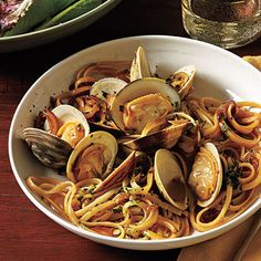 Serve an Italian-inspired dish featuring quick-cooking linguine and clams in a light, fresh white wine sauce.