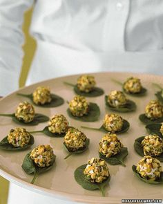 Goat-Cheese Appetizer - Give your wedding or bridal shower a Mediterranean flair with these simple hors d'oeuvres. Balls of fresh goat cheese are coated with chopped pistachios; beds of baby spinach leaves make them easy to lift and eat.