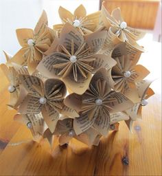 How to make a kusudama bouquet from folded book pages taped to fake flower stems.