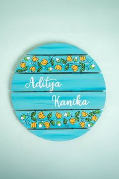 Hand-Painted Circular Shape Madhubani Lotus Design Teal Name Plate for your Home Entryway. Available in a number of monochromatic colors and traditional madhubani designs for an Indian touch to your Home Decor Wooden Name Plates, Door Name Plates, Name Plates For Home, Personalized Name Plates, Plates On Wall, Hand Painted Plates, Wooden Names, Name Board Design, Name Plate Design