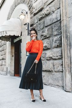 Vamp up your wardrobe with an autumnal update, bright orange long sleeve turtle neck blouse and a black midi skirt for ultimate sophistication