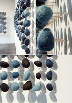 An installation by Roland Ricketts who created 400 indigo-dyed stones. Each piece was hand-felted, mounted on a stainless pin and meticulously set into the wall.